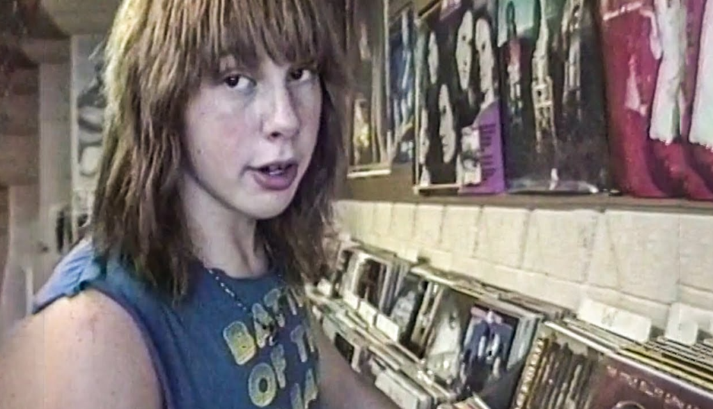 Two metalhead teens in a record store